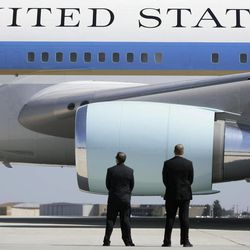 In this Saturday, Oct. 4, 2008 photo, Secret Service agents watch as Air Force One departs Midland International Airport with President Bush and first lady Laura Bush aboard in Midland, Texas. The Secret Service has been tarnished by a prostitution scandal that erupted April 13, 2012 in Colombia involving 12 Secret Service agents, officers and supervisors and 12 more enlisted military personnel ahead of President Barack Obama's visit there for the Summit of the Americas.