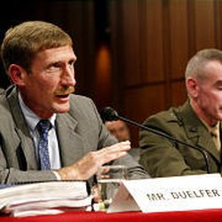 Charles Duelfer, left, head of the Iraq Survey Group, speaks to the Senate Armed Services Committee.