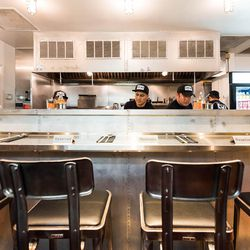 The four-seat counter in front of Chiko's open kitchen.