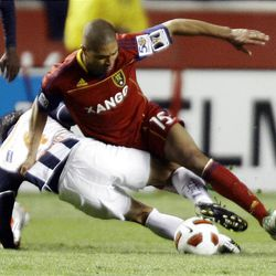 Alvaro Saborio of Real Salt Lake fights for control of the ball against Ricardo Osorio from the Rayados of Monterrey during the final game of the CONCACAF championship at Rio Tinto Stadium in Sandy Wednesday, April 27, 2011.
