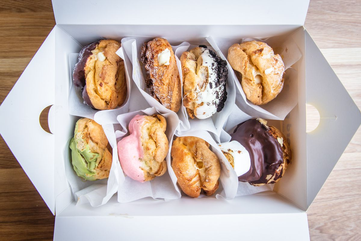 A to-go box filled with eight cream puffs
