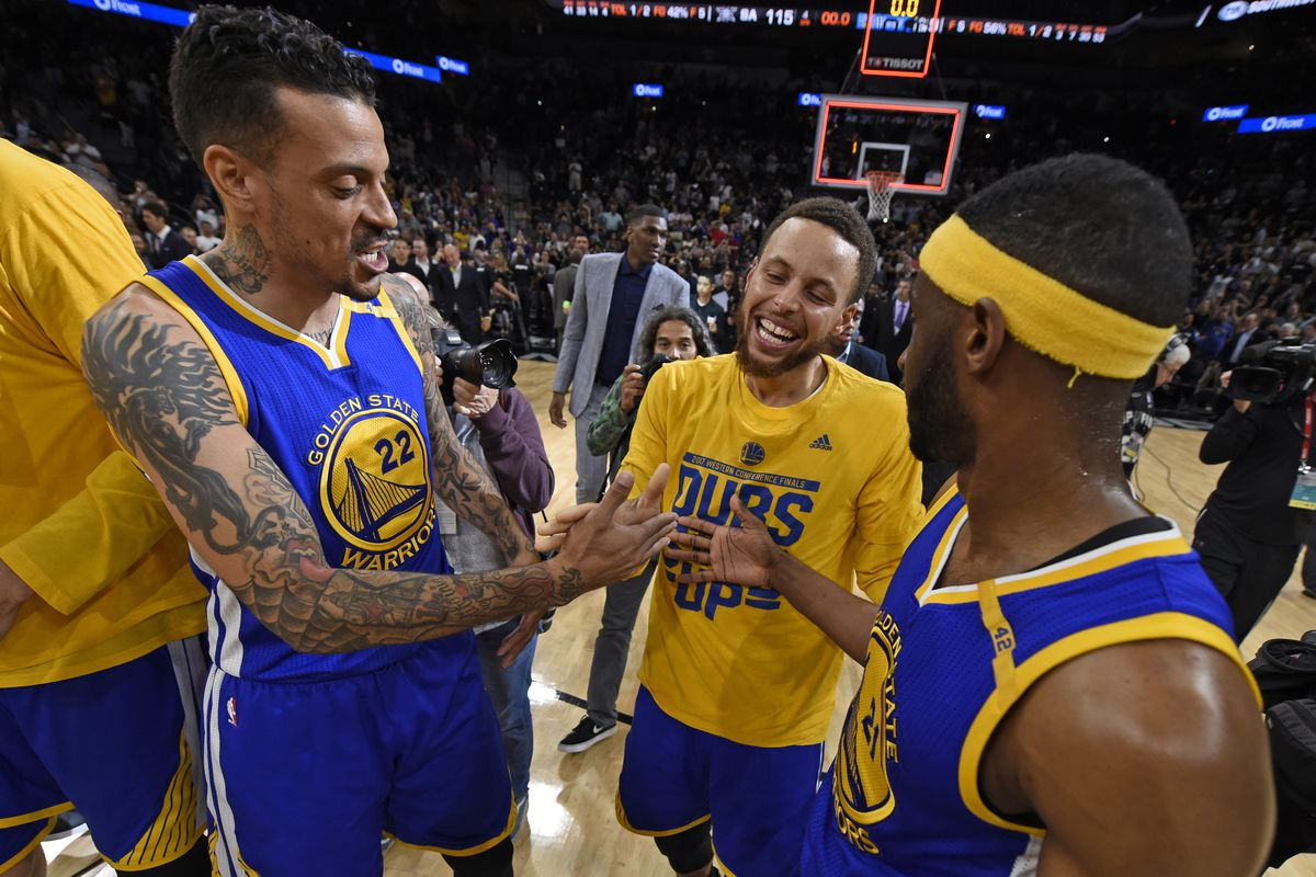 Golden State Warriors' Matt Barnes (22), Golden State Warriors' Stephen Curry (30) and Golden State Warriors' Ian Clark (21) celebrate winning Game 4 of the NBA Western Conference Finals at AT&T Center in San Antonio, Texas, on Monday, May 22, 2017. Golde