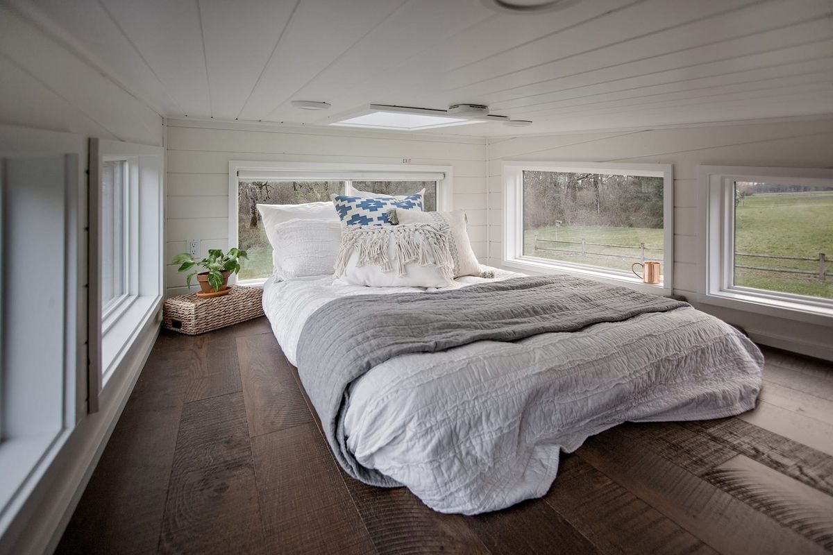 Bedroom with lots of windows