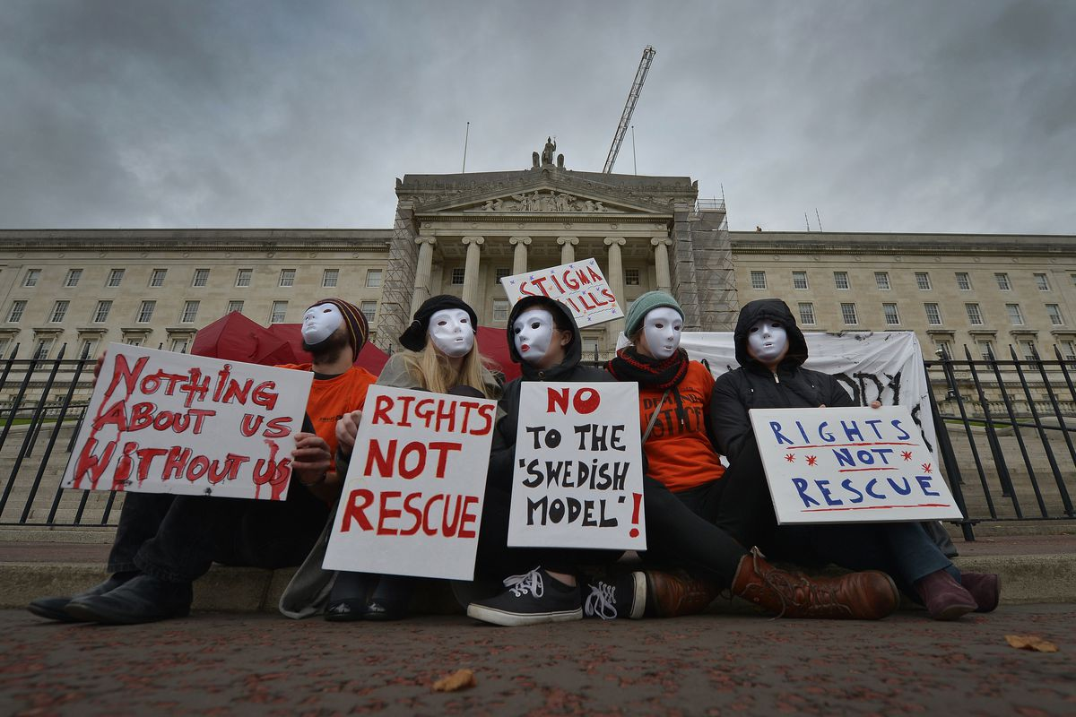 Sex workers wearing masks to protect their identity protest against a proposed human trafficking bill in Belfast, Northern Ireland