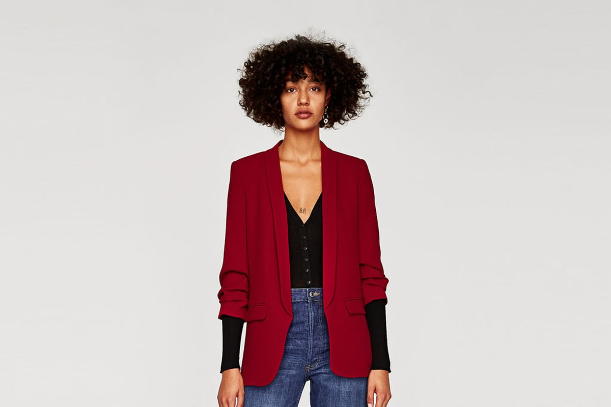 model in jeans and red blazer