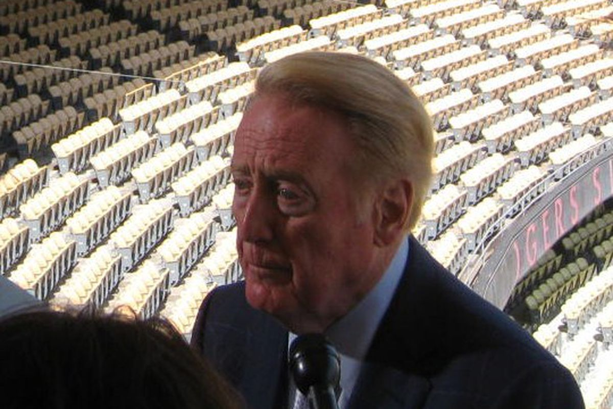 Vin Scully will be back for a 64th season with the Dodgers.