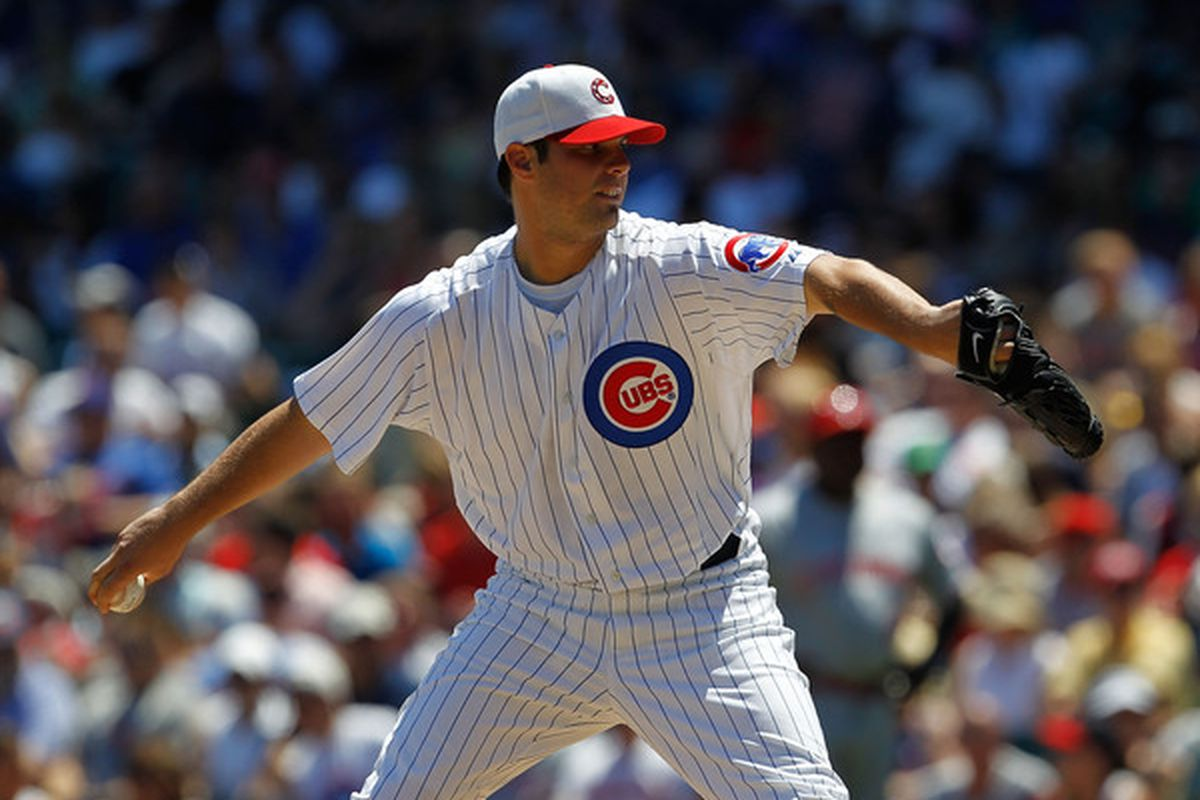 CHICAGO - JULY 03: Starting pitcher Randy Wells # 36 of the Chicago Cubs delivers the ball against the Cincinnati Reds at Wrigley Field on July 3 2010 in Chicago Illinois. The Cubs defeated the Reds 3-1.  (Photo by Jonathan Daniel/Getty Images)