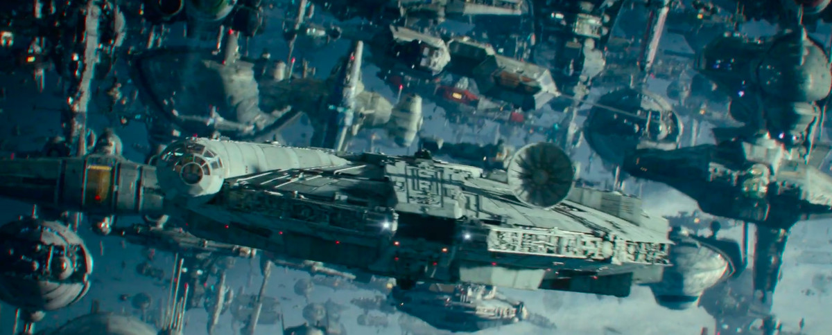 an intact millennium falcon leads a squad of ships into battle