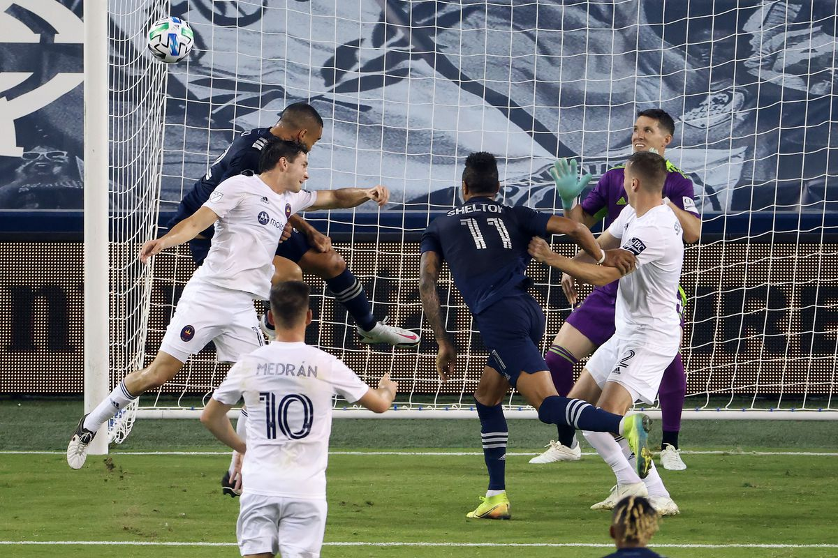Sporting Kansas City's Winston Reid scores against the Fire during their game earlier this month in Kansas City Kansas.