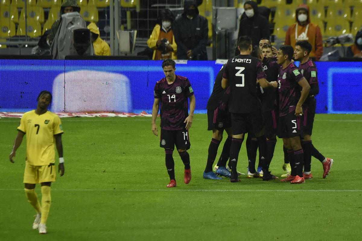 Mexico's Alexis Vega (C) celebrates after scoring against Jamaica during their Qatar 2022 FIFA World Cup Concacaf qualifier match at the Azteca stadium in Mexico City, on September 2, 2021.