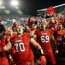 Utah Utes players celebrate their win over the Brigham Young Cougars at LaVell Edwards Stadium in Provo on Saturday, Sept. 9, 2017.
