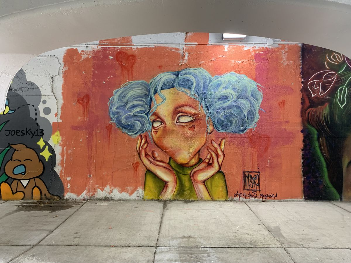 """This mural was done by South Side native Megan Kind, who lives in East Humboldt Park. She primarily paints """"characters that don't have noses or a mouth"""" because, she says, """"I want to focus on the eyes and a body language or some sort of movement."""""""