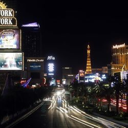 This Sunday, Oct. 8, 2017, photo shows the Las Vegas Strip before some of the casinos dim their marquees signs for about 10 minutes in Las Vegas, to pay tribute to the victims who spent that much time under fire in the Las Vegas shooting on Sunday, Oct. 1. (AP Photo/Steve Marcus)