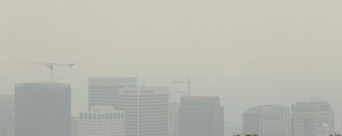 The view of Salt Lake City is obscured by smoke from the California and Oregon wildfires on Friday, Aug. 6, 2021. Wildfires from the West have produced huge columns of smoke that have drifted as far east as New York, creating some of the worst air quality that state has seen in 15 years.