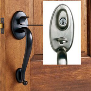 <p><strong>Entry Handleset</strong><br>An entry handleset combines a tubular lockset and deadbolt in one matching set. Instead of a round knob, a thumblatch retracts the lower spring-loaded mechanism. On most handlesets, only the deadbolt is keyed. Some manufacturers offer<br> the option of a keyed thumblatch, which provides a way of securing the door in addition to the deadbolt. <br><strong>Shown:</strong> Baldwin, Logan series in Venetian bronze, $305; inset: Kwikset, Gibson in satin nickel, $