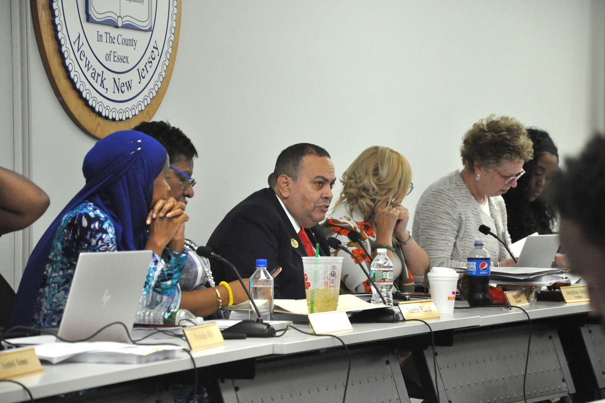 Newark Superintendent Roger León and board members discuss agenda items at the first board meeting of the school year.
