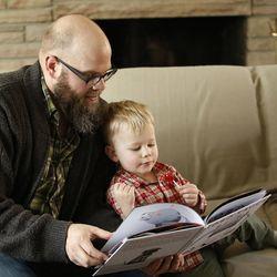 Blair Christensen reads to his son Seth at home in Salt Lake City Thursday, Jan. 21, 2016.