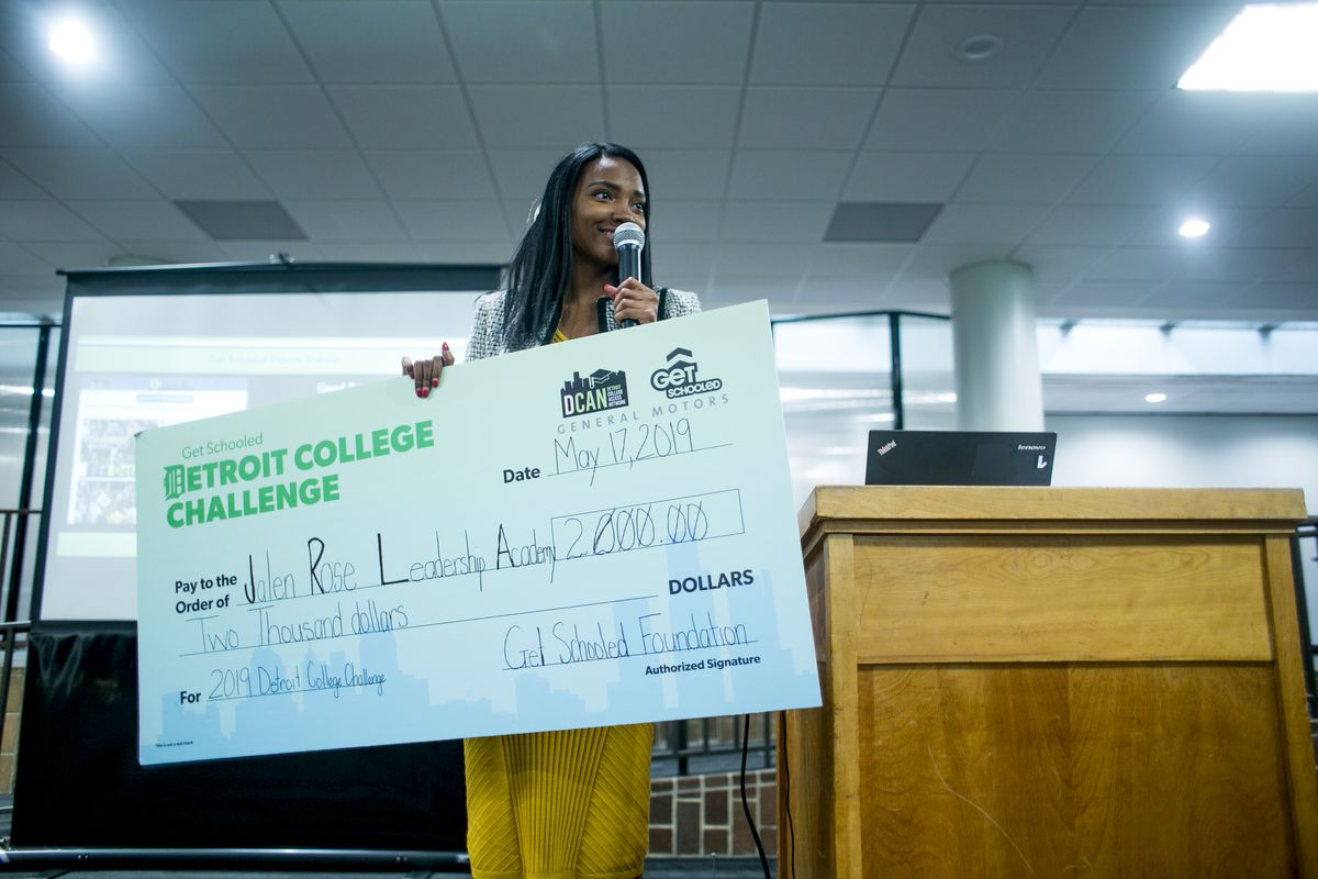 Ashley Johnson, executive director of the Detroit College Access Network, shared good news during a signing day and college decision day ceremony for the Jalen Rose Leadership Academy in May: The school had won $2,000 as part of a contest.
