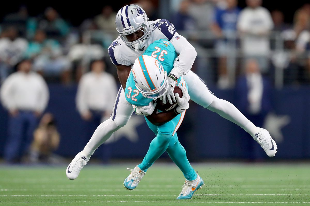 Kenyan Drake of the Miami Dolphins carries the ball against Chidobe Awuzie of the Dallas Cowboys in the second quarter at AT&T Stadium on September 22, 2019 in Arlington, Texas.