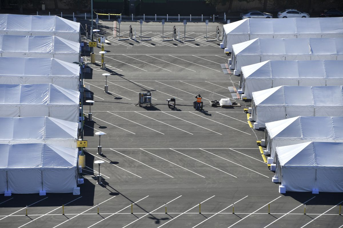 COVID-19 vaccination tents are set up in the north of the Toy Story parking lot at the Disneyland Resort on Tuesday, Jan. 12, 2021, in Anaheim, Calif.