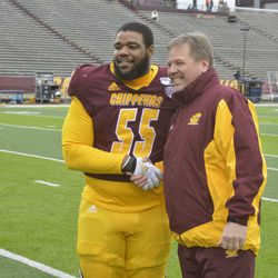 D'Andre Dill and Jim McElwian shake hands during Senior Day ceremonies.