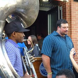 Former Patriot Joe Andruzzi hold courts on Forum's patio. Andruzzi was holding a fundraiser for his foundation at Forum when the bombs went off. All those present on April 15 were invited to the restaurant's private reopening.