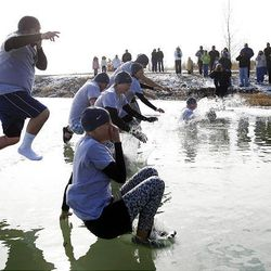Team Walmart, from the Saratoga Springs store, jump into icy Utah Lake Saturday during the Polar Plunge.