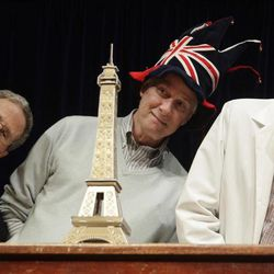 Nobel Prize laureates Eric Maskin, Rich Roberts and Dudley Herschbach lean over behind a mini Eiffel Tower during a performance at the Ig Nobel Prize ceremony at Harvard University, in Cambridge, Mass., Thursday, Sept. 20, 2012. The Ig Nobel prize is an award handed out by the Annals of Improbable Research magazine for silly sounding scientific discoveries that often have surprisingly practical applications.