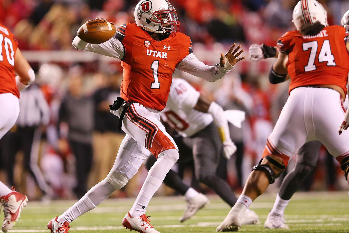 Utah Utes quarterback Tyler Huntley (1) delivers a pass on the run as Utah and Washington State play a College football game at Rice Eccles Stadium at the University of Utah in Salt Lake City on Saturday, Nov. 11, 2017.