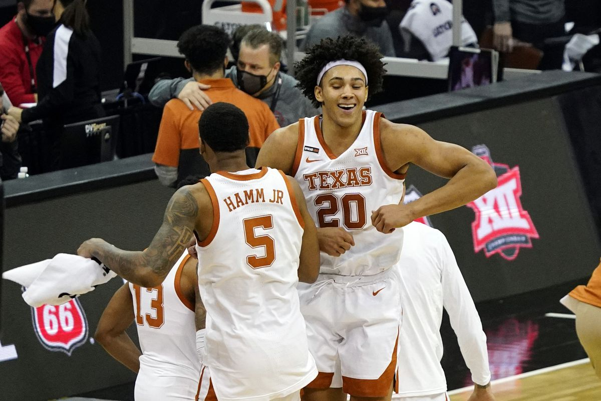 Texas Longhorns forward Jericho Sims celebrates with forward Royce Hamm Jr. after defeating the Texas Tech Red Raiders at T-Mobile Center.