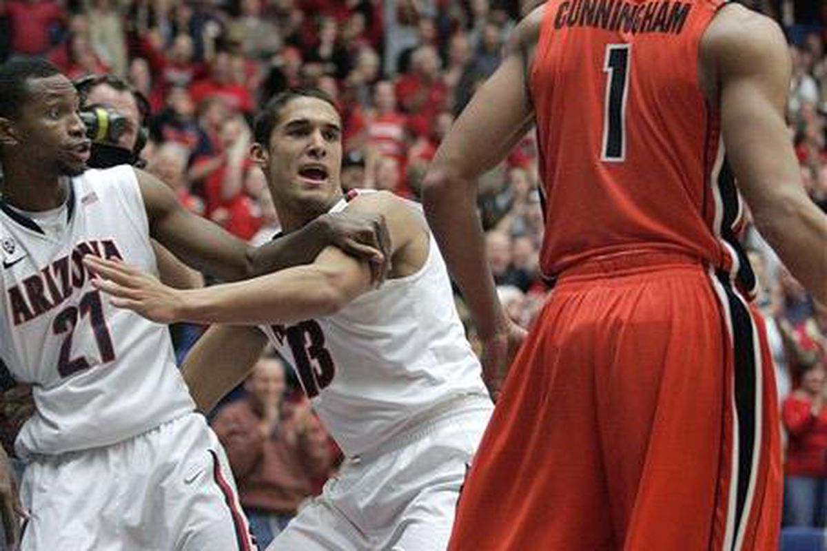 Kyle Fogg (21) and Jared Cunningham both had lots of points and lots of fouls the first time the 'Cats and the Beavers got together. Expect more action tonight from the two Pac-12 All-Conference players. <em>(AP Photo)</em>