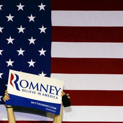 A supporter holds up a sign for Republican presidential candidate, former Massachusetts Gov. Mitt Romney at an election night rally in Manchester, N.H., Tuesday, April 24, 2012. (AP Photo/Jae C. Hong)
