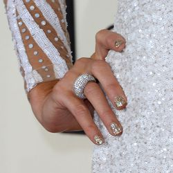 Paris is going to have fun removing that glitter nail polish later.