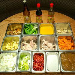 The ingredients: (top row l-r) rice vinegar, dark soy sauce, light soy sauce. <br> (second row) Orange peels, Shanghai bok choy, fresh orange juice, garlic. <br> (third row) Ginger, raw sweetbreads, trimmed sweetbreads, carrots. <br> (bottom row) Onion