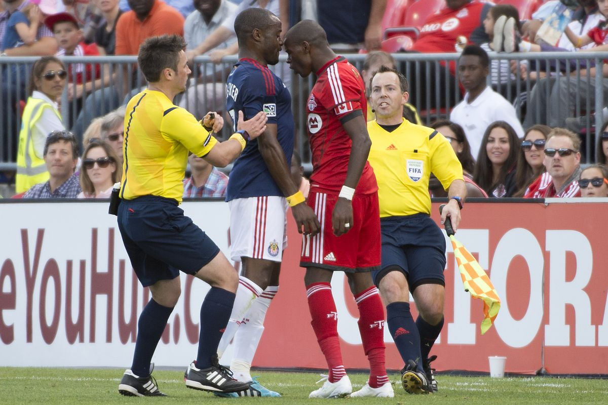 Never one to shy away from confrontation, Jackson squares up to Nigel Reo-Coker having given TFC the lead against Chivas