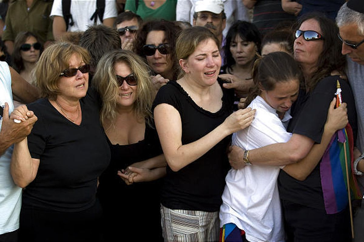 Relatives of Israeli Nir Katz, who was killed in an attack on a gay club, grieve during his funeral in the Israeli city of Modiin near Tel Aviv on Sunday. A teenage girl was also killed. Reeling from the attack, members of the country's gay community and
