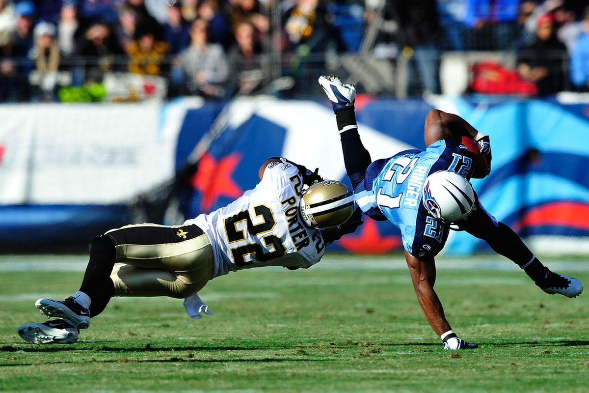 NASHVILLE, TN - DECEMBER 11:  Tracy Porter #22 of the New Orleans Saints ipends Javon Ringer #21 of the Tennessee Titans during play at LP Field on December 11, 2011 in Nashville, Tennessee.  (Photo by Grant Halverson/Getty Images)