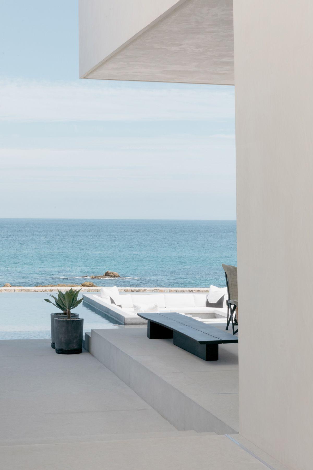 An outdoor terrace has ocean views.