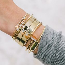 """""""We have a personalized collection, where you can engrave a bangle with letters, or with a date,"""" Stephanie says. Check out Jemma Wynne's take on the ID bracelet, at the bottom of her bangle stack."""