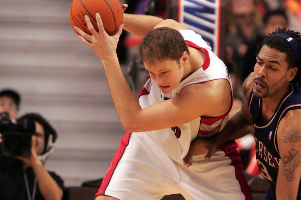 15/12/06-RAPSvNETS-Raptors Rasho Netserovic protects a rebound from the Nets Mikki Moore during the