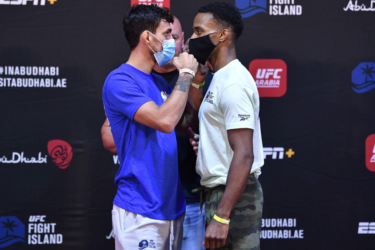 Opponents Ricardo Ramos of Brazil and Lerone Murphy of England face off during the UFC Fight Night weigh-in inside Flash Forum on UFC Fight Island on July 14, 2020 in Yas Island, Abu Dhabi, United Arab Emirates.