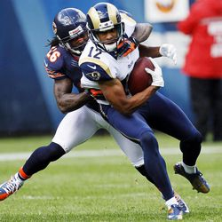 St. Louis Rams wide receiver Steve Smith (12) is tackled from behind by Chicago Bears cornerback Tim Jennings (26) in the first half of an NFL football game in Chicago, Sunday, Sept. 23, 2012.