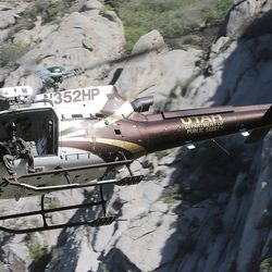 A Utah Department of Public Safety helicopter leaves the Bell Canyon falls area after dropping off members of the Salt Lake County Search and Rescue team in an effort to recover the body of a 22-year-old hiker who fell on Monday, June 5, 2017. Siaosi Brown's body was spotted in the lower falls of the canyon. His body was trapped on some logs in the middle of the waterfall, Unified Police Lt. Brian Lohrke said.