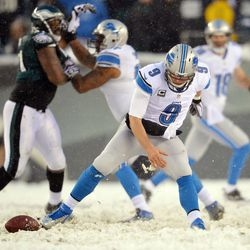 Matthew Stafford drops a snap into the snow