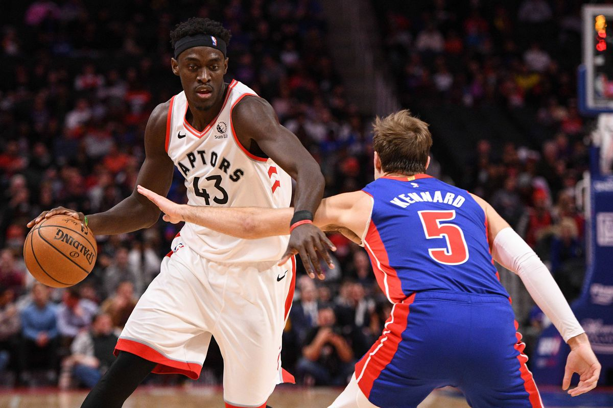 Toronto Raptors forward Pascal Siakam drives to the basket against Detroit Pistons guard Luke Kennard during the first half at Little Caesars Arena.
