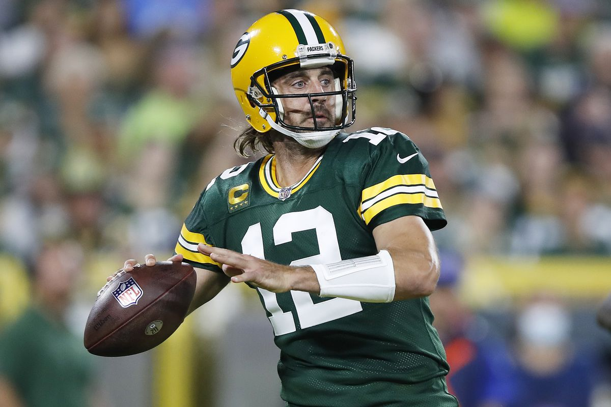 Aaron Rodgers #12 of the Green Bay Packers passes against the Detroit Lions during the first half at Lambeau Field on September 20, 2021 in Green Bay, Wisconsin.