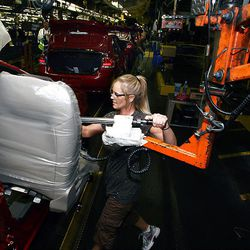 Ford employees work on the 2010 Ford Focus at a plant in Wayne, Mich., Wednesday. The Focus was a popular car in Cash for Clunkers.
