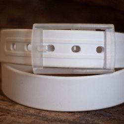 """Made from 100% recycled materials, Huckstraps' <a href=""""http://huckstraps.com/collections/huckstraps/products/huckstrap-white"""">White Belt</a> ($24.95) is one-size fits all. Just cut the rubber strap to your size and attach the """"huck"""" buckle."""