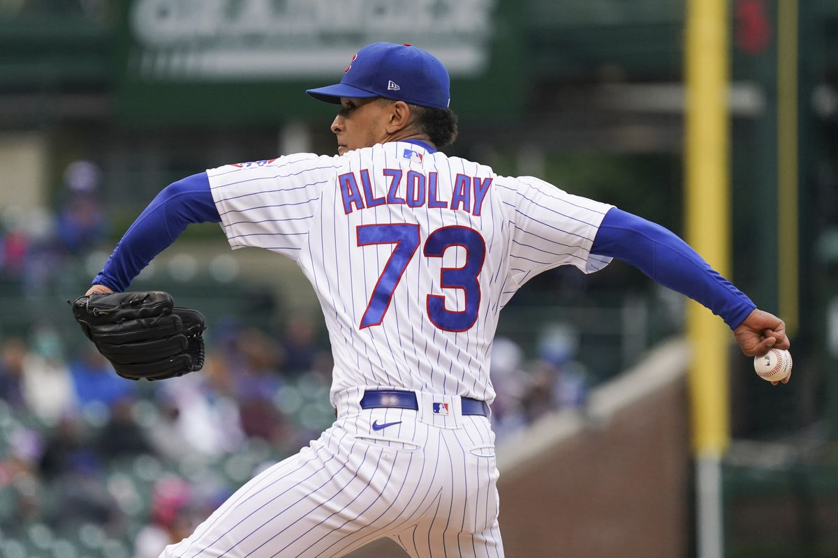 Adbert Alzolay #73 of the Chicago Cubs throws a pitch during the first inning of a game against the Cincinnati Reds at Wrigley Field on May 28, 2021 in Chicago, Illinois.