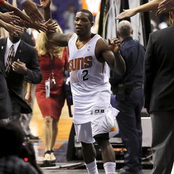 Phoenix Suns' Eric Bledsoe leaves the court after making the game-winning basket against the Utah Jazz in an NBA basketball game, Friday, Nov. 1, 2013, in Phoenix. The Suns won 87-84.